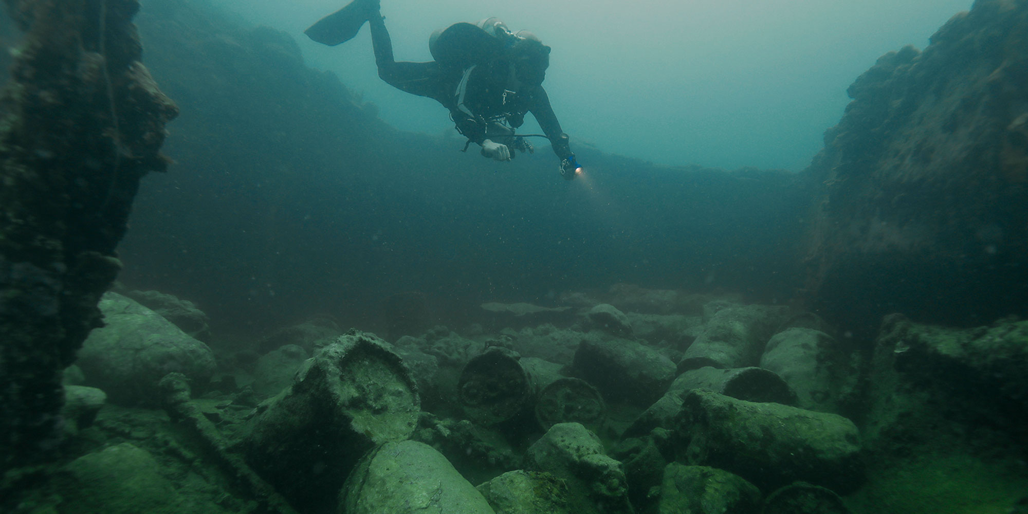 Matt Carter inspecting leaking unexploded ordnance on a WWII wreck in Palau